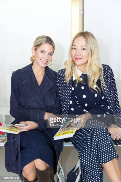 Helena Bordon and Tina Leung attend the Michael Kors Collection Fall 2018 Runway Show at the Vivian Beaumont Theatre on February 14 2018 in New York...
