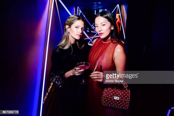 Helena Bordon and Tina Leung attend TSUM 110th Anniversary Celebration Party on October 26 2017 in Moscow Russia