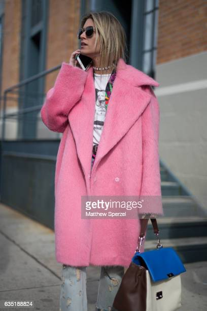 Helena Bordon is seen attending Carolina Herrera during New York Fashion Week wearing a pink coat on February 13 2017 in New York City