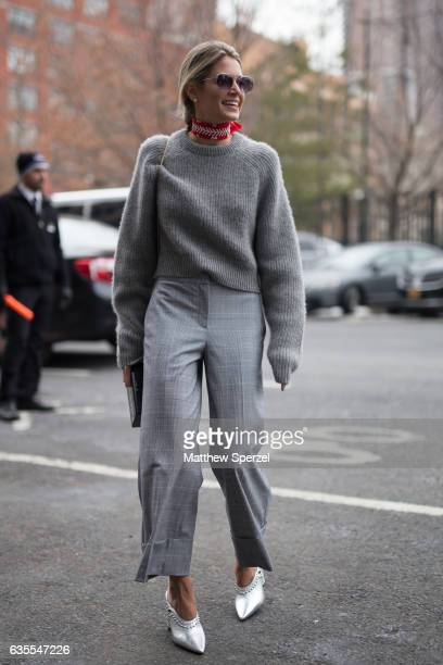 Helena Bordon is seen attending Michael Kors during New York Fashion Week wearing a grey sweater grey pants and red scarf on February 15 2017 in New...