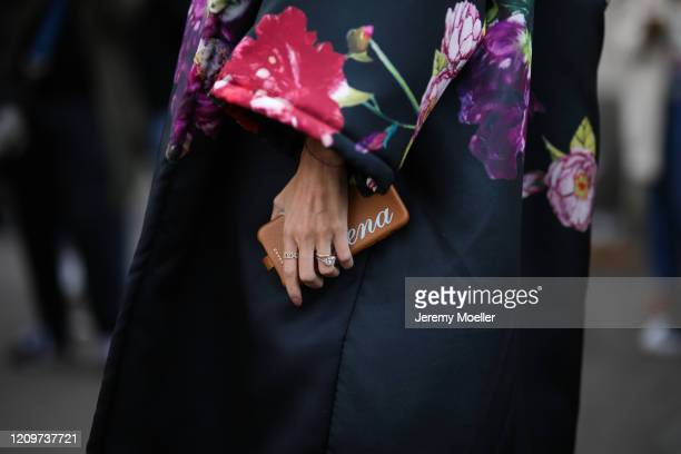 Helena Bordon is seen holding her Chaos Iphone Case and wearing a flower print cape outside the Elie Saab show during Paris Fashion week Womenswear...