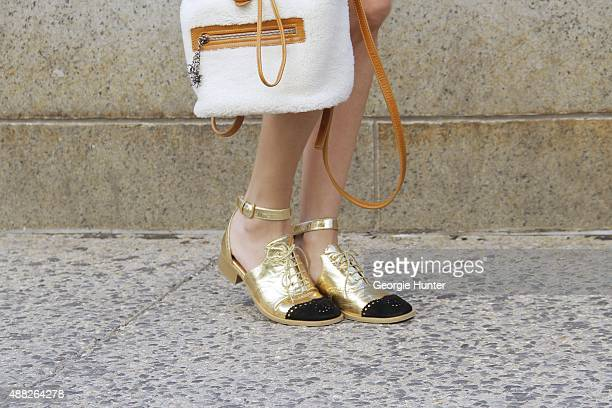 Helena Bordon is seen on the streets of Manhattan outside of the Jeremy Scott Spring 2016 fashion show at Skylight at Moynihan Station wearing pink...