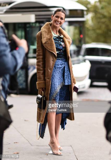 Helena Bordon is seen wearing a brown Chloe coat and blue Chloe dress outside the Chloe show during Paris Fashion Week SS20 on September 26, 2019 in...