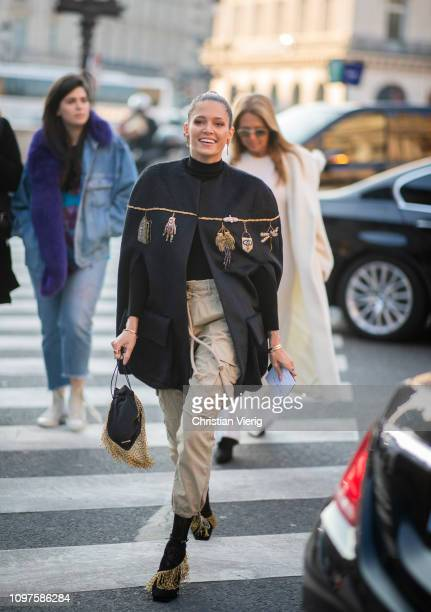Helena Bordon is seen wearing cape beige pants outside Schiaparelli during Paris Fashion Week Haute Couture Spring Summer 2019 on January 21 2019 in...