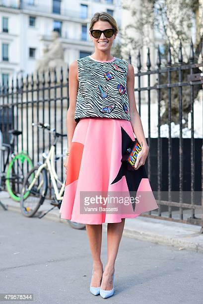 Helena Bordon poses wearing an MSGM dress and Les Petits Joueurs clutch before the Atelier Versace show at the Palais Brogniart on July 5 2015 in...