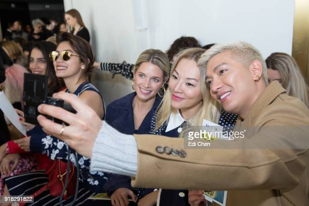 Helena Bordon Tina Leung and Bryan Yambao attend the Michael Kors Collection Fall 2018 Runway Show at the Vivian Beaumont Theatre on February 14 2018...