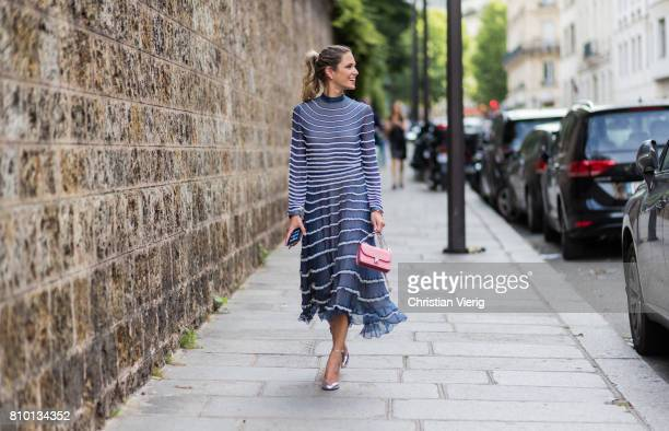 Helena Bordon wearing a blue white stripped dress outside Valentino during Paris Fashion Week Haute Couture Fall/Winter 20172018 Day Four on July 5...