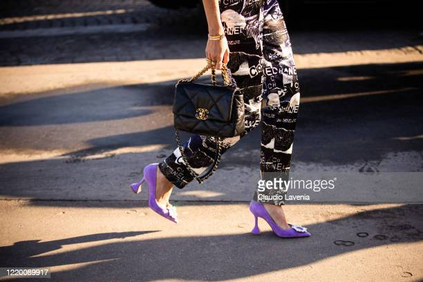 Helena Bordon, wearing a Chanel printed jumpsuit, lilac heels and black Chanel bag, is seen outside Chanel, during Paris Fashion Week - Haute Couture...