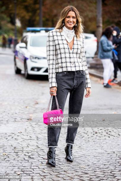 Helena Bordon, wearing a checked blazer, Chanel scarf, grey jeans, black boots and fuchsia bag, is seen outside the Chanel show during Paris Fashion...