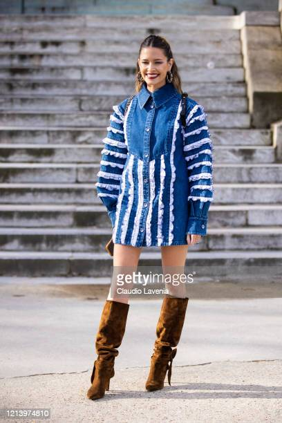Helena Bordon, wearing a decorated denim shirt dress and brown boots, is seen outside Chanel, during Paris Fashion Week - Womenswear Fall/Winter...
