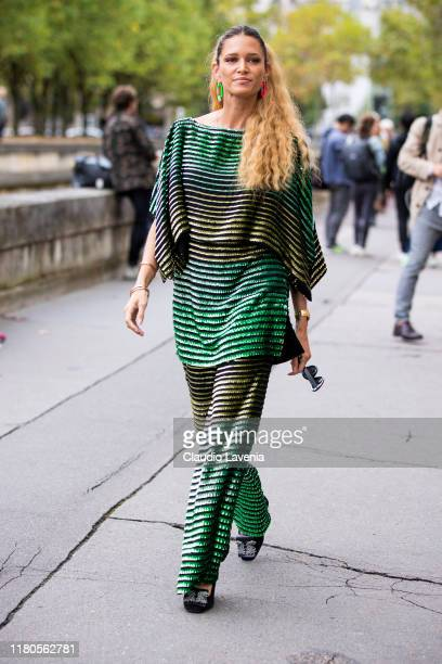 Helena Bordon wearing a green decorated top with matching pants is seen outside the Valentino show during Paris Fashion Week Womenswear Spring Summer...