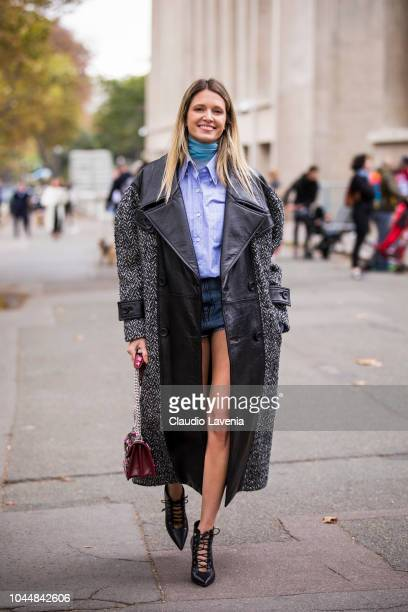 Helena Bordon wearing a light blue shirt denim mini skirt black heels burgundy bag and long black coat is seen before the Miu Miu show on October 2...