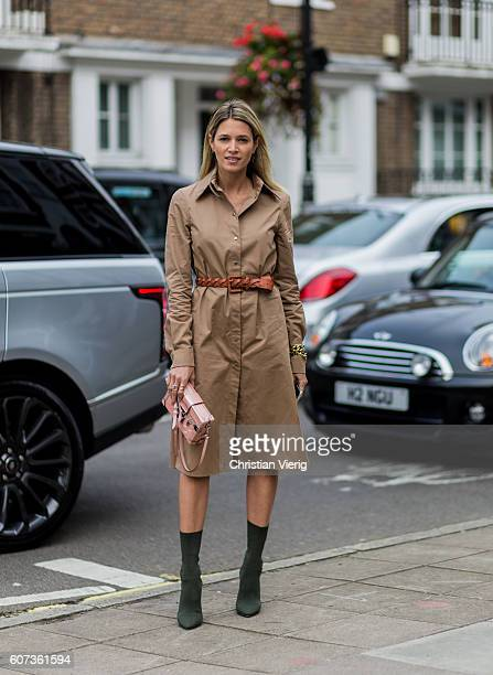 Helena Bordon wearing a trench coat belt green boots and clutch outside of Julien Macdonald during London Fashion Week Spring/Summer collections 2017...