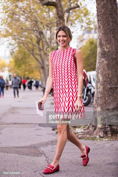 Helena Bordon wearing a Valentino printed mini dress red bag and red loafers is seen before the Valentino show on September 30 2018 in Paris France