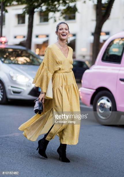 Helena Bordon wearing a yellow dress outside Fendi during Paris Fashion Week Haute Couture Fall/Winter 20172018 Day Four on July 5 2017 in Paris...