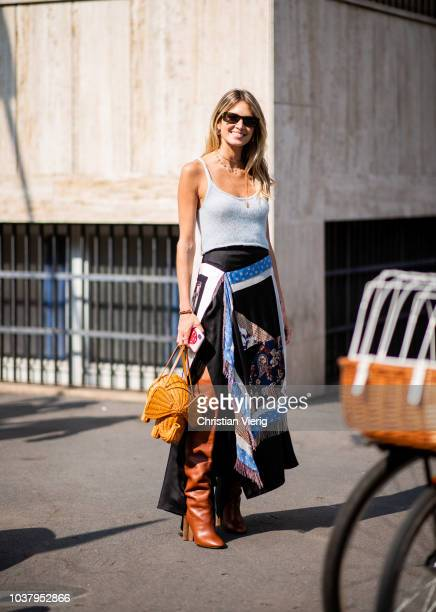 Helena Bordon wearing basket bag with elephant design skirt with print is seen outside Etro during Milan Fashion Week Spring/Summer 2019 on September...