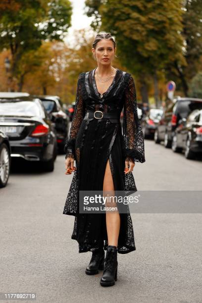 Helena Bordon wearing black lace maxy dress with a belt outside the Elie Saab show during Womenswear Spring/Summer 2020 show Paris Fashion Week on...