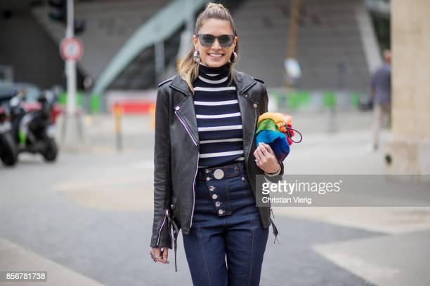 Helena Bordon wearing black leather jacket striped knit navy denim jeans white boots seen outside Giambattista Valli during Paris Fashion Week...