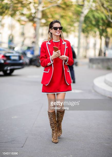 Helena Bordon wearing boots with leopard print red dress and red blazer is seen outside Issey Miyake during Paris Fashion Week Womenswear...