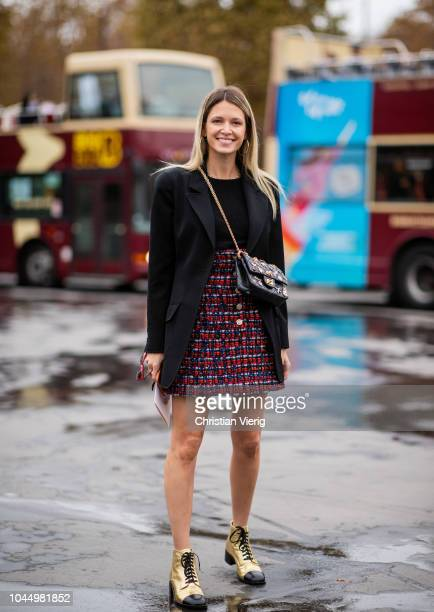 Helena Bordon wearing Chanel skirt black blazer jacket golden boots is seen outside Chanel during Paris Fashion Week Womenswear Spring/Summer 2019 on...