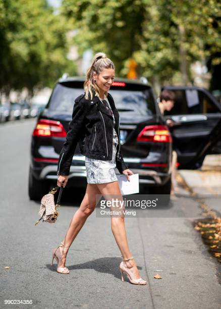 Helena Bordon wearing Dior bag and bag with back print is seen outside Dior on day two during Paris Fashion Week Haute Couture FW18 on July 2 2018 in...