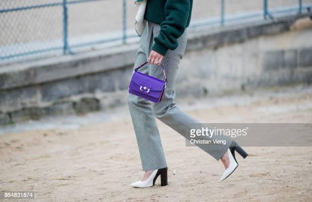 Helena Bordon wearing grey pants purple mini bag white heels green knit is seen outside Lacoste during Paris Fashion Week Spring/Summer 2018 on...