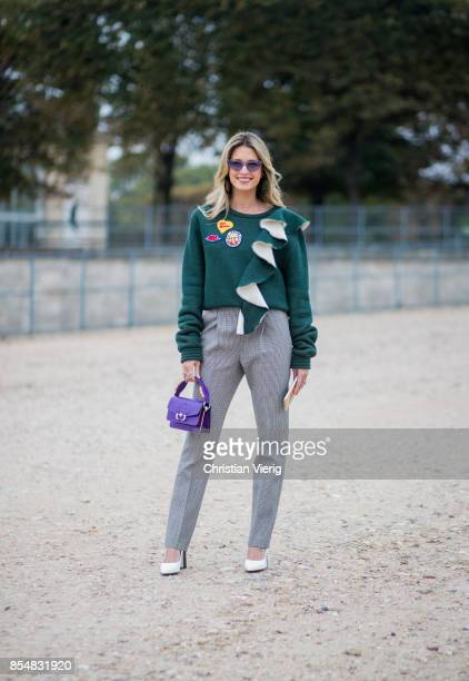 Helena Bordon wearing grey pants purple mini bag white heels green knit is seen outside Lacoste during Paris Fashion Week Spring/Summer 2018 on...
