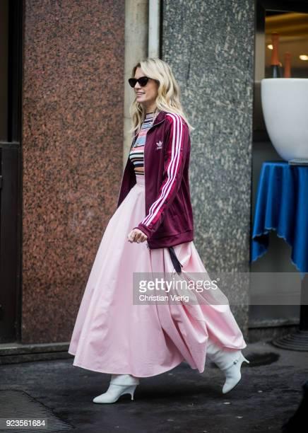 Helena Bordon wearing pink skirt Adidas jacket seen outside Sportmax during Milan Fashion Week Fall/Winter 2018/19 on February 23 2018 in Milan Italy