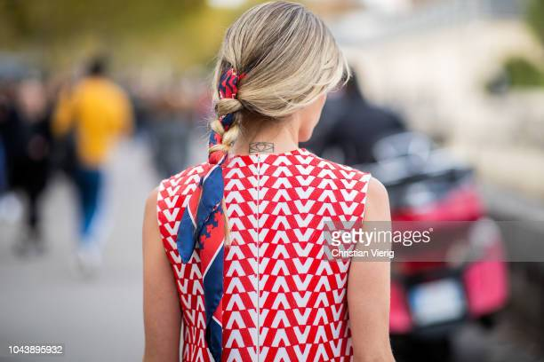 Helena Bordon wearing scarf wattled in her hair red white sleeveless Valentino dress is seen outside Valentino during Paris Fashion Week Womenswear...