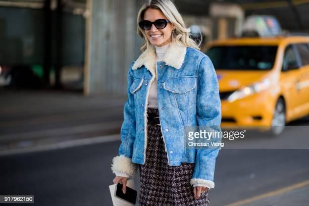 Helena Bordon wearing shearling denim jacket white turtleneck black overknee boots skirt seen outside Coach on February 13 2018 in New York City