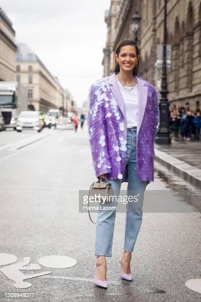 Helena Bordon wearing The Attico purple spangle jacket, Hermes mini beige leather bag, jeans and violet heels outside Giambattista Valli during Paris...