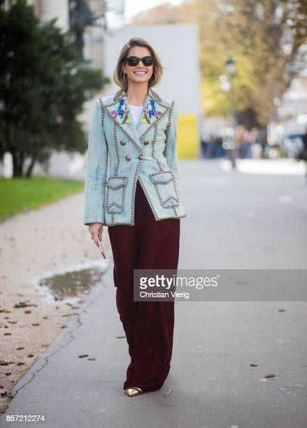 Helena Bordon wearing velvet pants blazer jacket seen outside Moncler Gamme Rouge during Paris Fashion Week Spring/Summer 2018 on October 3 2017 in...