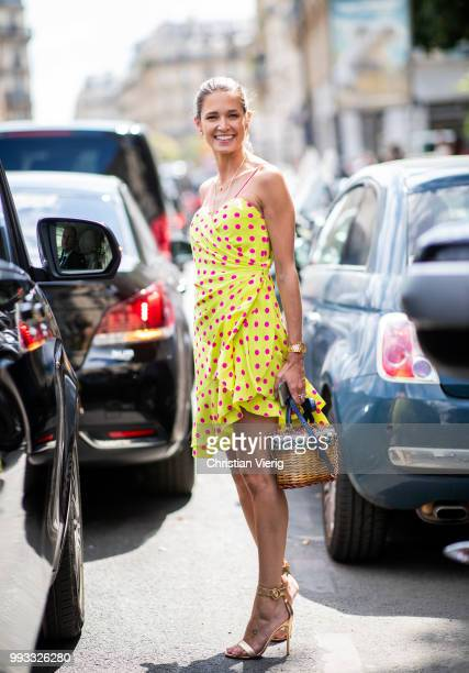 Helena Bordon wearing yellow summer dress with dots print, basket bag, heels seen outside Jean Paul Gaultier on day four during Paris Fashion Week...