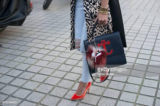 Helena Bordon wears a Pedro Lorenzo coat Current Elliott jeans Fendi Monster pom pom Maria Sole bag on day 2 of Paris Collections Women on February...