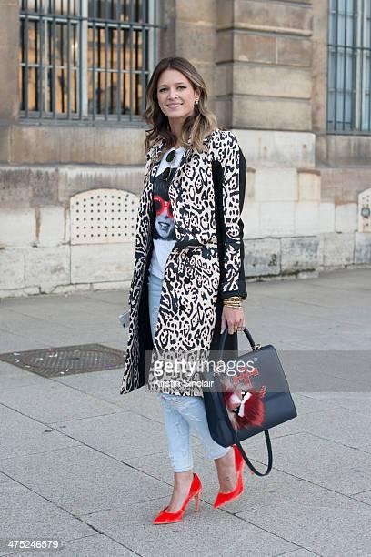 Helena Bordon wears a Pedro Lorenzo coat Current Elliott jeans Fendi Monster pom pom Rock top Rayban sunglasses Maria Sole bag on day 2 of Paris...