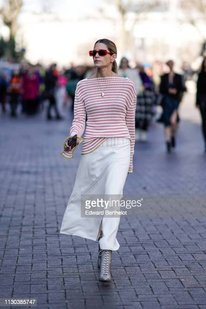 Helena Bordon wears a red and white striped top white skirt sunglasses during London Fashion Week February 2019 on February 17 2019 in London England