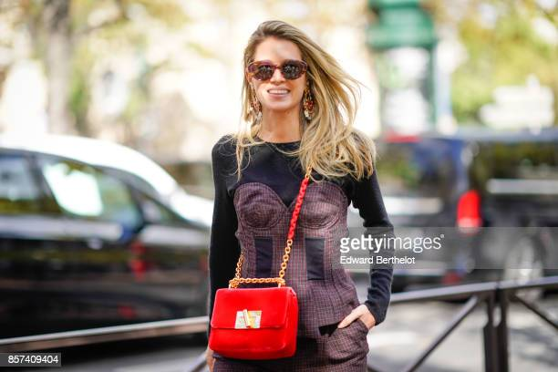 Helena Bordon wears a red bag outside Miu Miu during Paris Fashion Week Womenswear Spring/Summer 2018 on October 3 2017 in Paris France