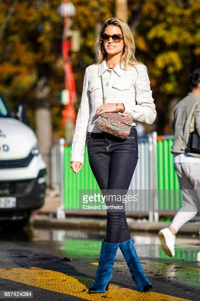 Helena Bordon wears a white jacket black pants blue boots outside Chanel during Paris Fashion Week Womenswear Spring/Summer 2018 on October 3 2017 in...