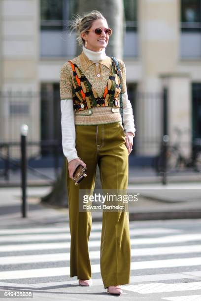 Helena Bordon wears khaki pants a white turtle neck outside the Miu Miu show during Paris Fashion Week Womenswear Fall/Winter 2017/2018 on March 7...