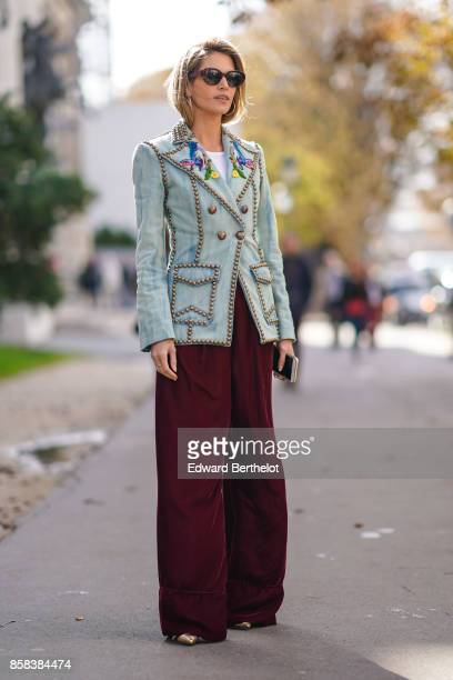Helena Bordon wears sunglasses a jacket red pants outside Moncler during Paris Fashion Week Womenswear Spring/Summer 2018 on October 3 2017 in Paris...