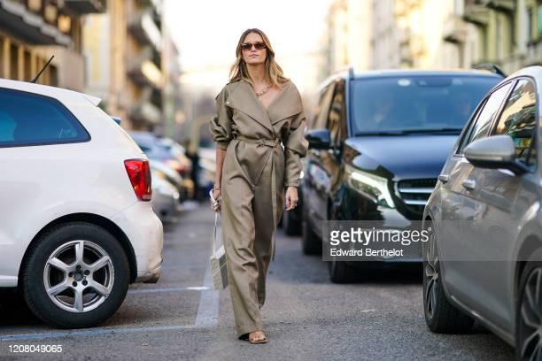 Helena Bordon wears sunglasses, a jumpsuit, a white rectangular bag, outside Bottega Veneta, during Milan Fashion Week Fall/Winter 2020-2021 on...