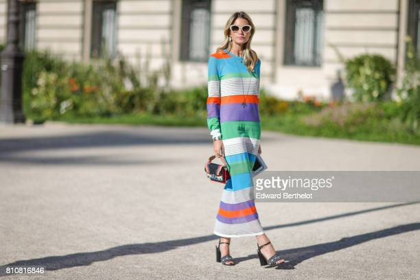 Helena Bordon wears sunglasses a striped dress outside the Giambattista Valli show during Paris Fashion Week Haute Couture Fall/Winter 20172018 on...