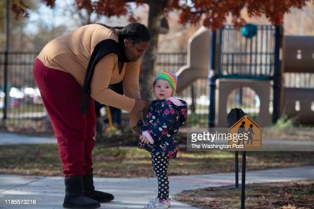 Helena Bryant-Holland a student an intern, helps Thia Miller, 2 with her coat at a child care center at Anne Arundel Community College in Arnold,...