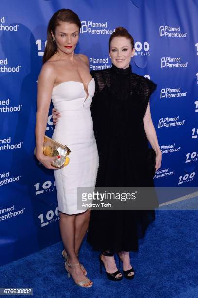 Helena Christensen and Julianne Moore attend the Planned Parenthood 100th Anniversary Gala at Pier 36 on May 2 2017 in New York City