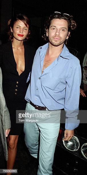 Helena Christensen and Michael Hutchence at the Emporium Club in London, United Kingdom.