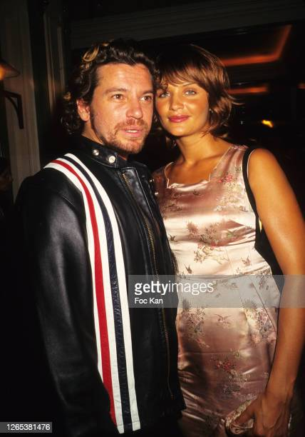 Helena Christensen and Michael Hutchence attend the Venus de La Mode Awards Party at Les Bains during Paris Fashion Week in the 1990s in Paris,...