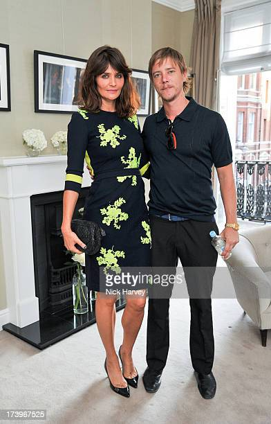 Helena Christensen and Paul Banks attend MATCHESFASHIONCOM Partners With Rika On 'Iron Girl' Project For Rika Magazine on July 18 2013 in London...