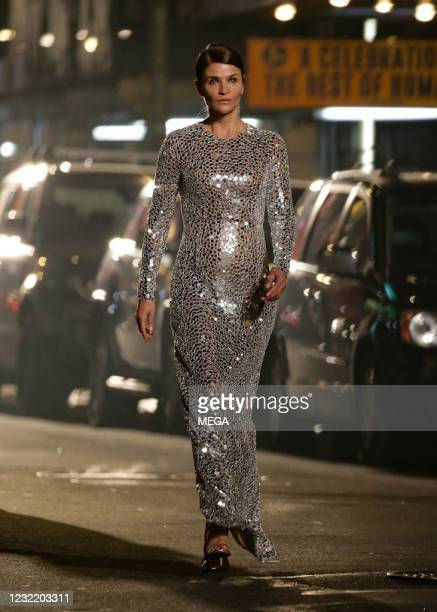 Helena Christensen is seen walking in the Michael Kors fashion show in Times Square on April 8, 2021 in New York City.
