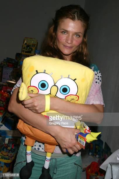 Helena Christensen poses with SpongeBob SquarePants toy