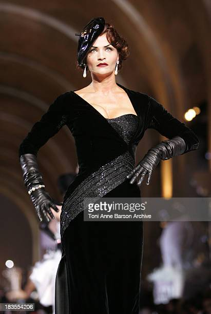 Helena Christensen walks down the catwalk wearing Dior Haute Couture Fall/Winter 2008 on July 2 in Versailles France
